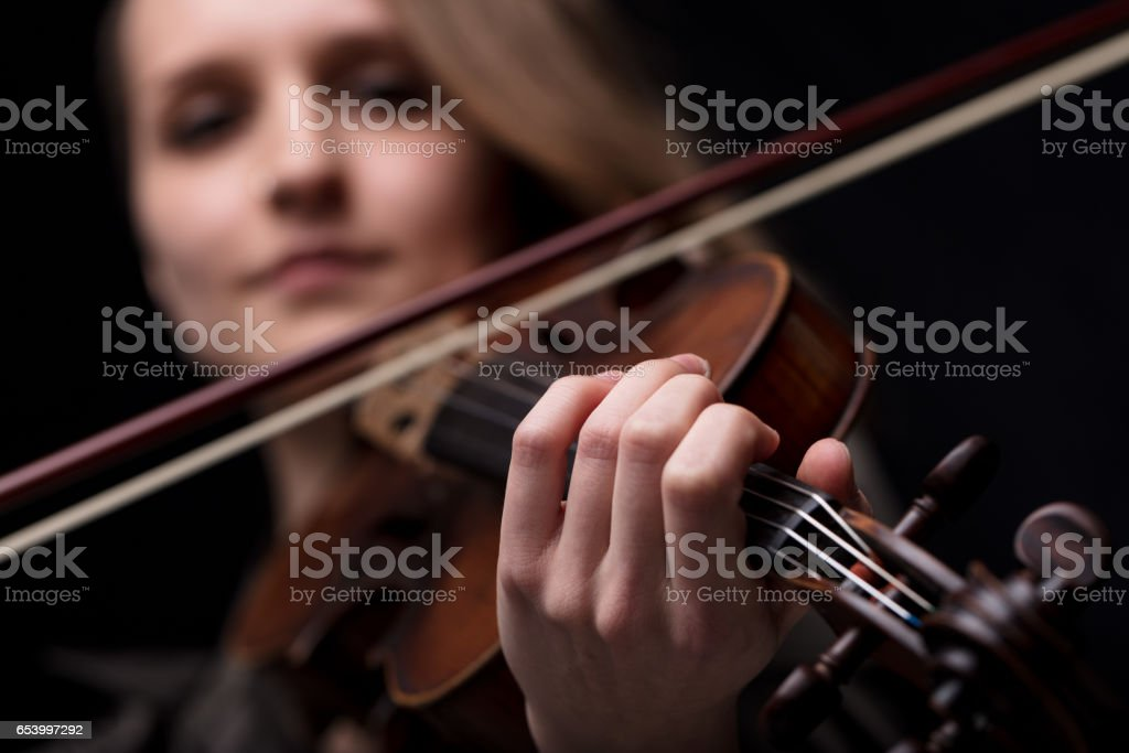 hand of a violinist playing stock photo