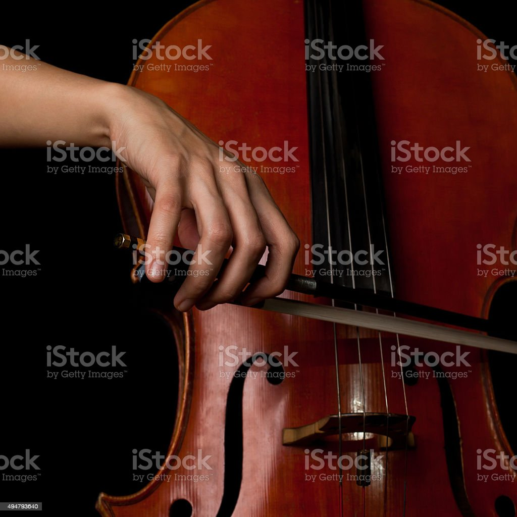Hand of a woman playing the cello stock photo