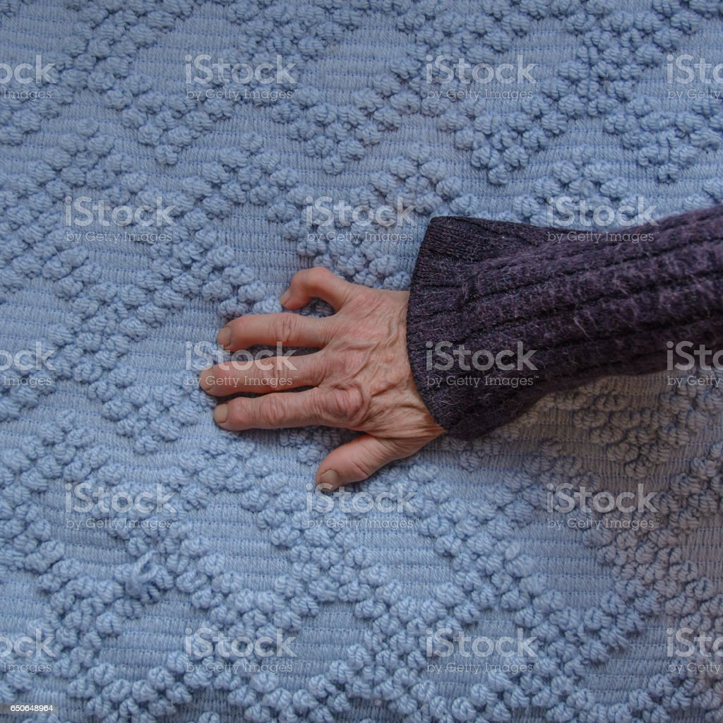 Hand of an old working woman stock photo