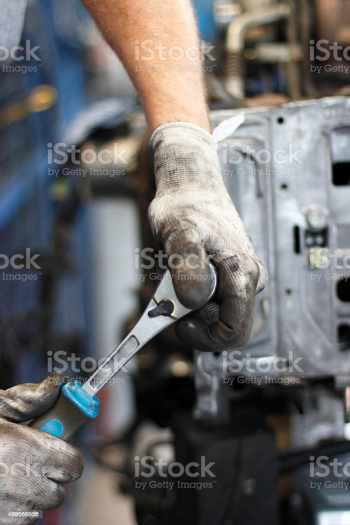 Hand of auto mechanic stock photo