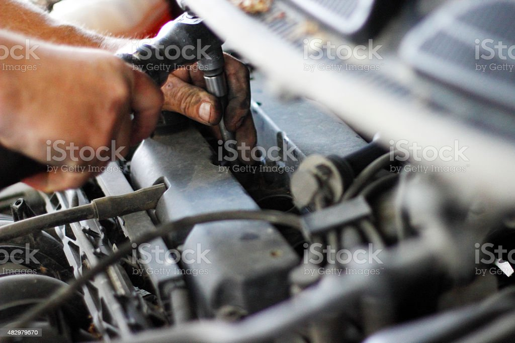 Hand of auto mechanic with a wrench stock photo