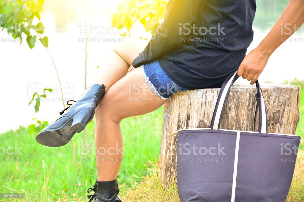 Hand of bandit steal bag another person in the public stock photo