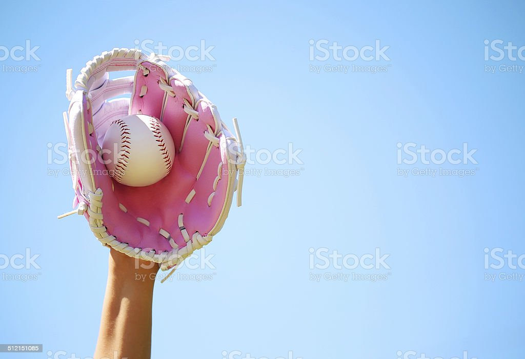 Hand of Baseball Player with Pink Glove and Ball stock photo