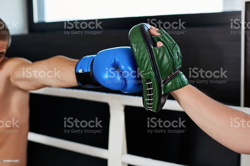 Hand of boxer and training gloves stock photo