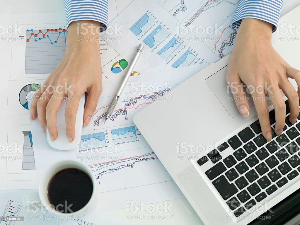 Hand of business woman working in a multi-task . stock photo