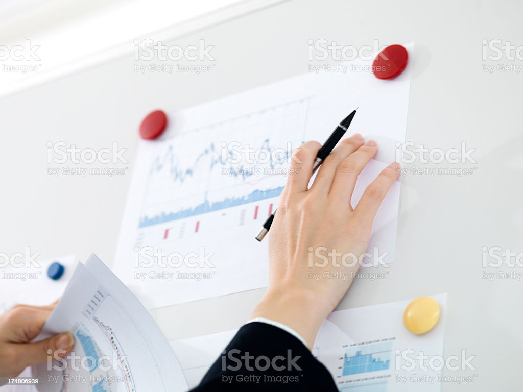 Hand of businessman and useful document on the whiteboard. royalty-free stock photo