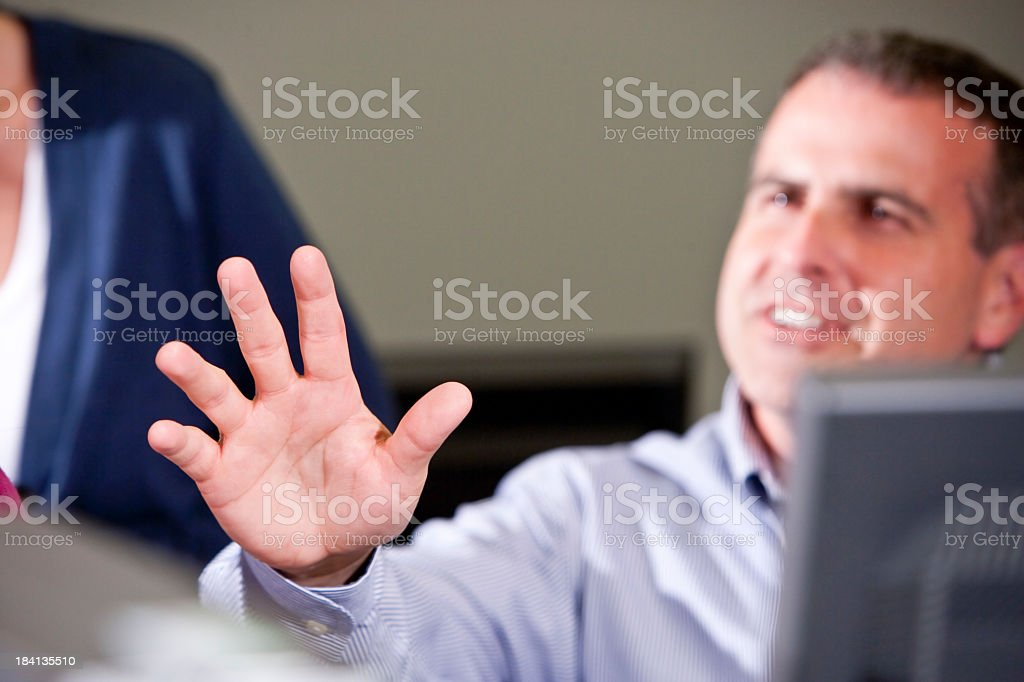 Hand of businessman gesturing in meeting stock photo