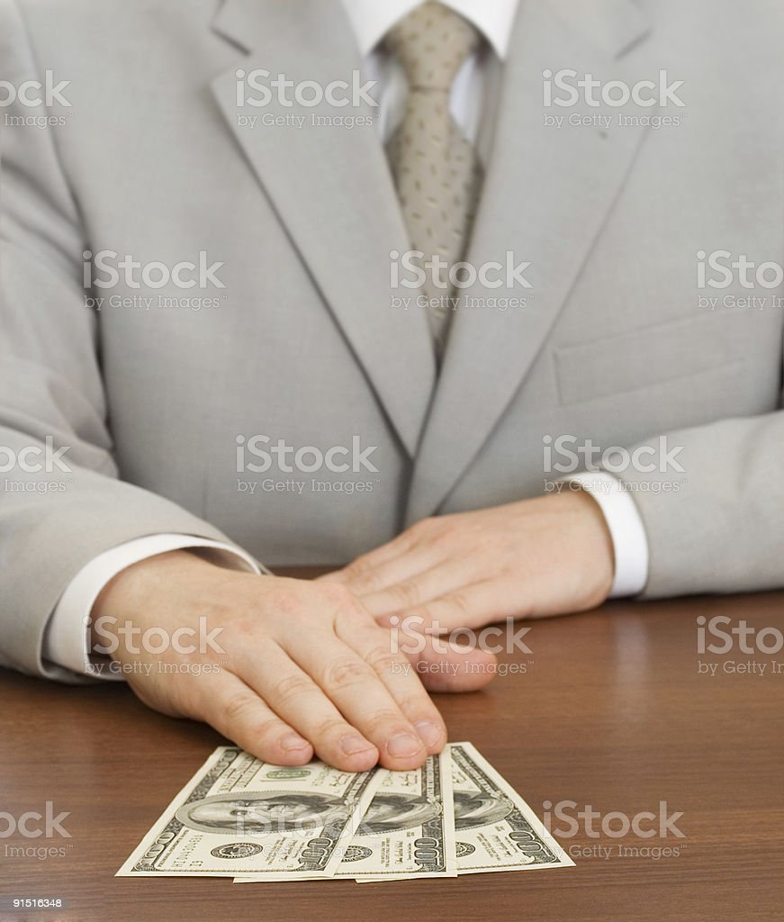 Hand of businessman holding dollars royalty-free stock photo