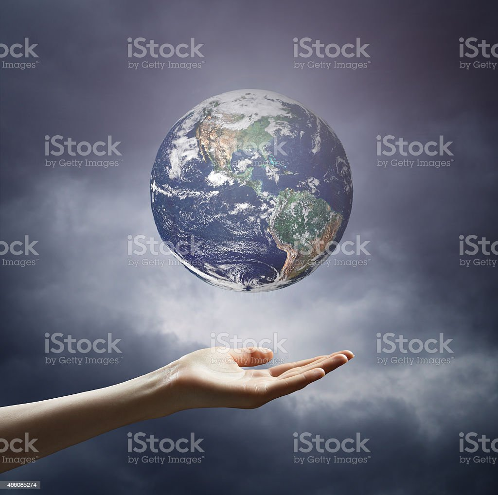 Hand of businessman holding earth planet stock photo
