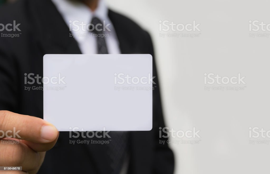 Hand of businessman holding the white card on white background. stock photo