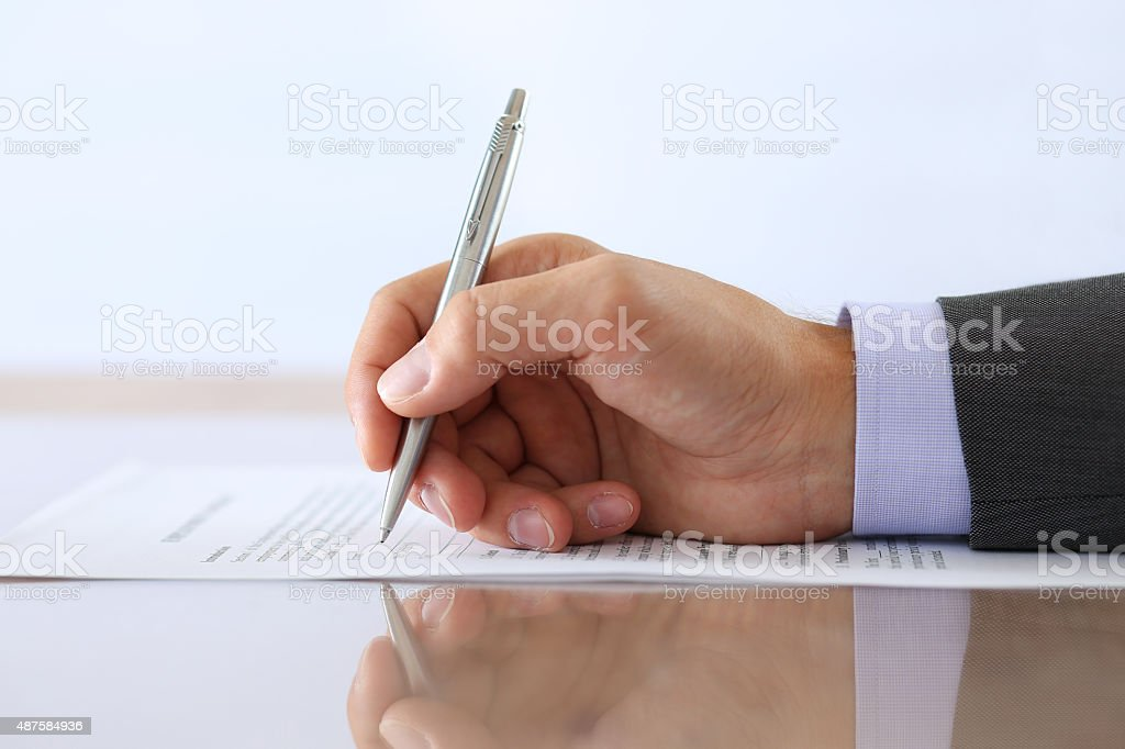 Hand of businessman in suit stock photo