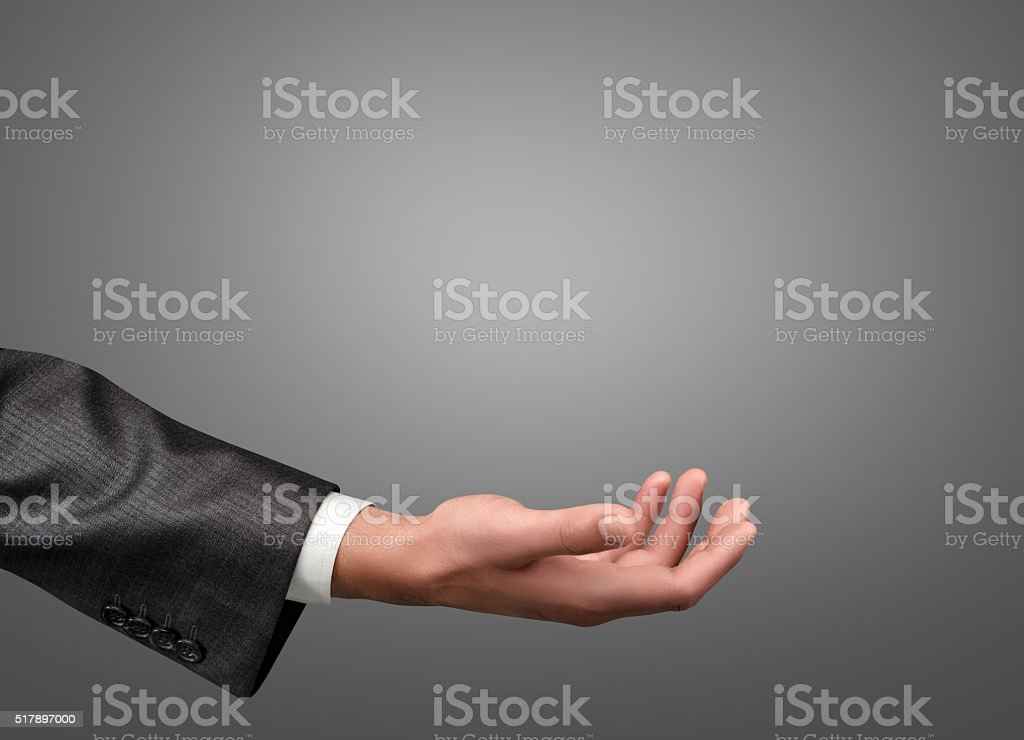 Hand of businessman palm up stock photo