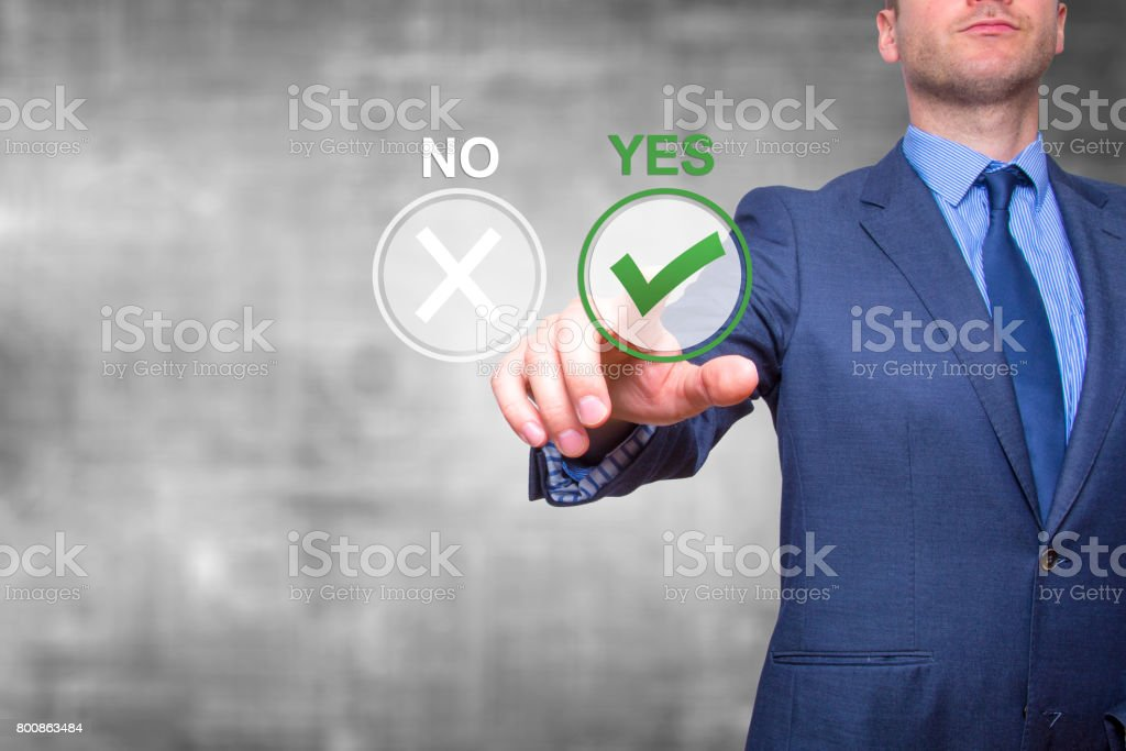 Hand of businessman press Yes button. Concept of decision making. Isolated on grey. Stock Image stock photo