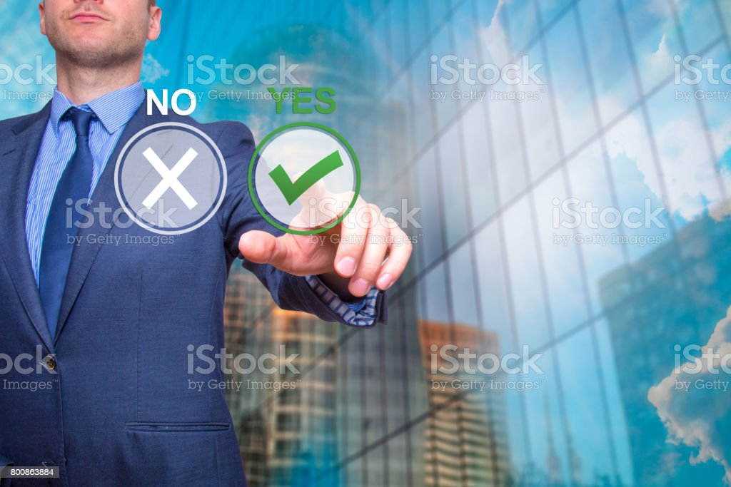 Hand of businessman press Yes button. Concept of decision making. Isolated on Skyscraper. Stock Image stock photo