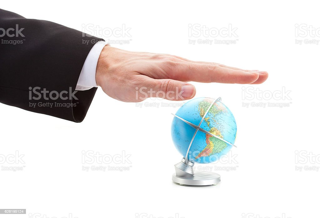 hand of businessman protecting the globe stock photo