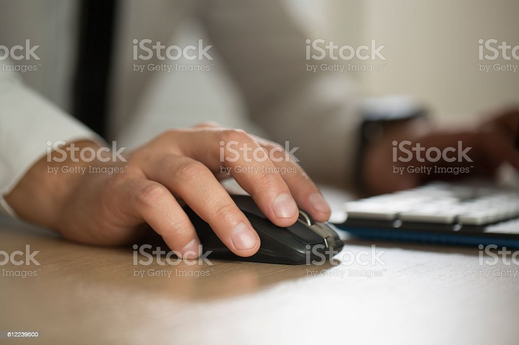 Hand of businessman use computer mouse and typing, partnership a stock photo