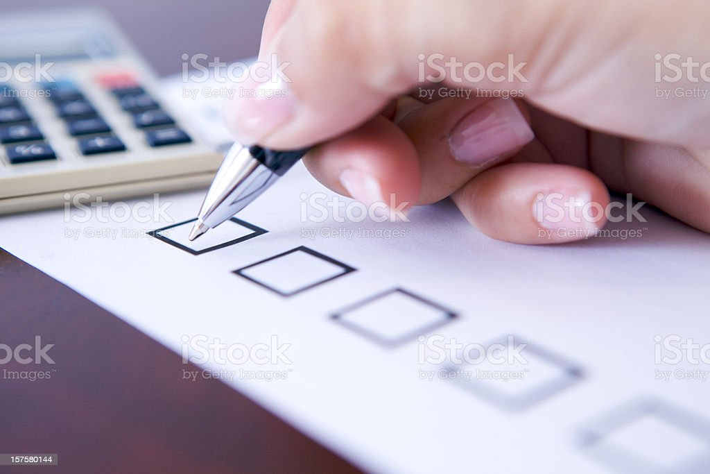 Hand of businesswoman about to start filing her to-do list royalty-free stock photo