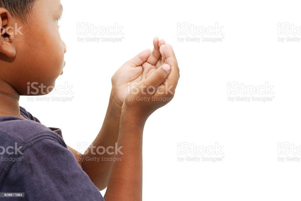 Hand of child praying stock photo