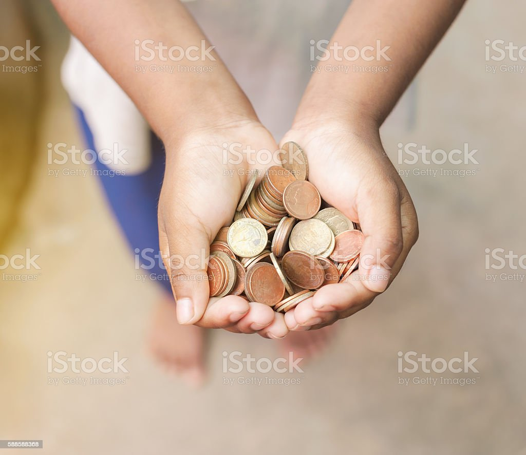 Hand of child with coins stock photo