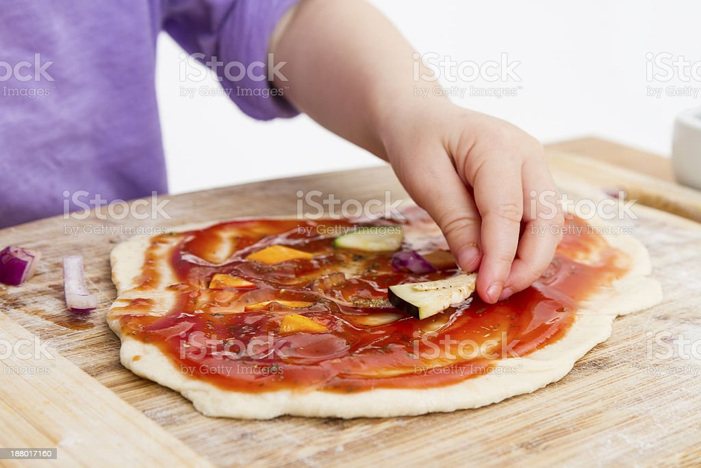 hand of cld making fresh pizza stock photo