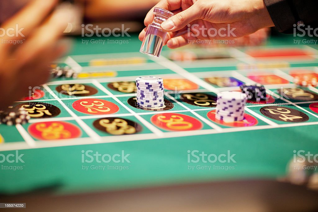 Hand of dealer declaring a winner at the roulette table royalty-free stock photo