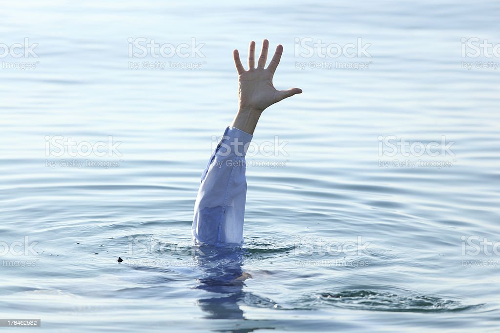 Hand of drowning man stock photo