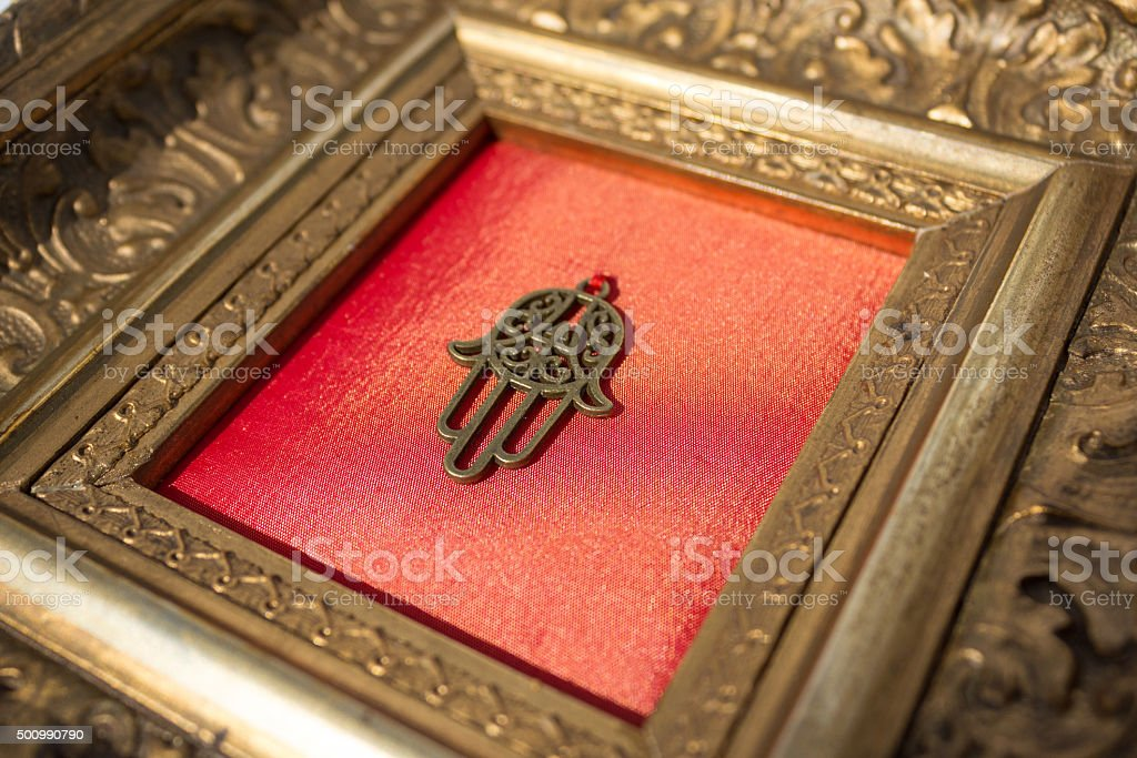 hand of fatima in decorative golden frame stock photo