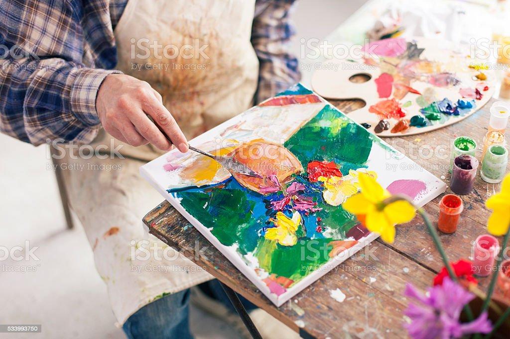 Hand of fine art painter creating new artwork-hight angle view stock photo