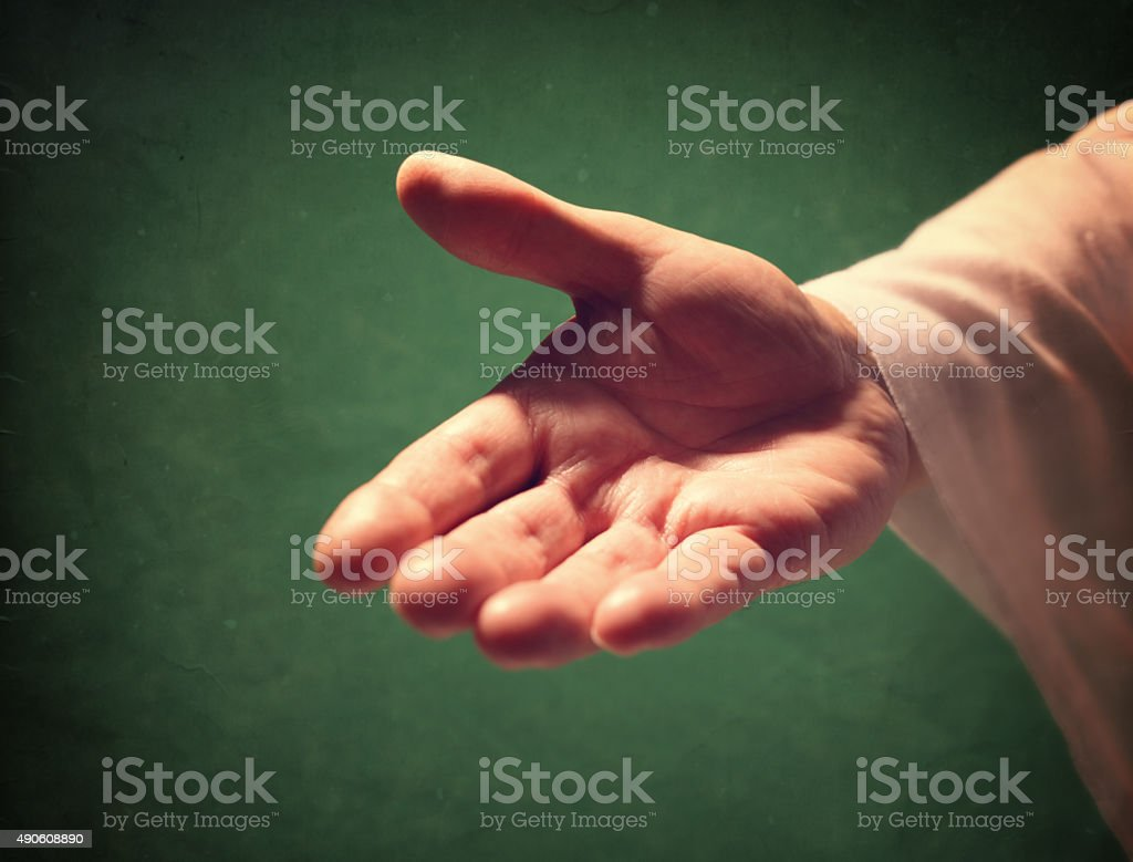 Hand of God reaching out stock photo