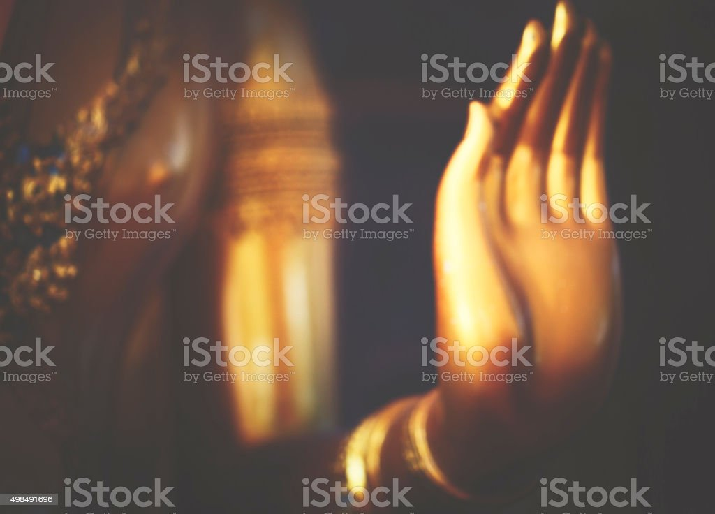 Hand of golden Buddha stock photo