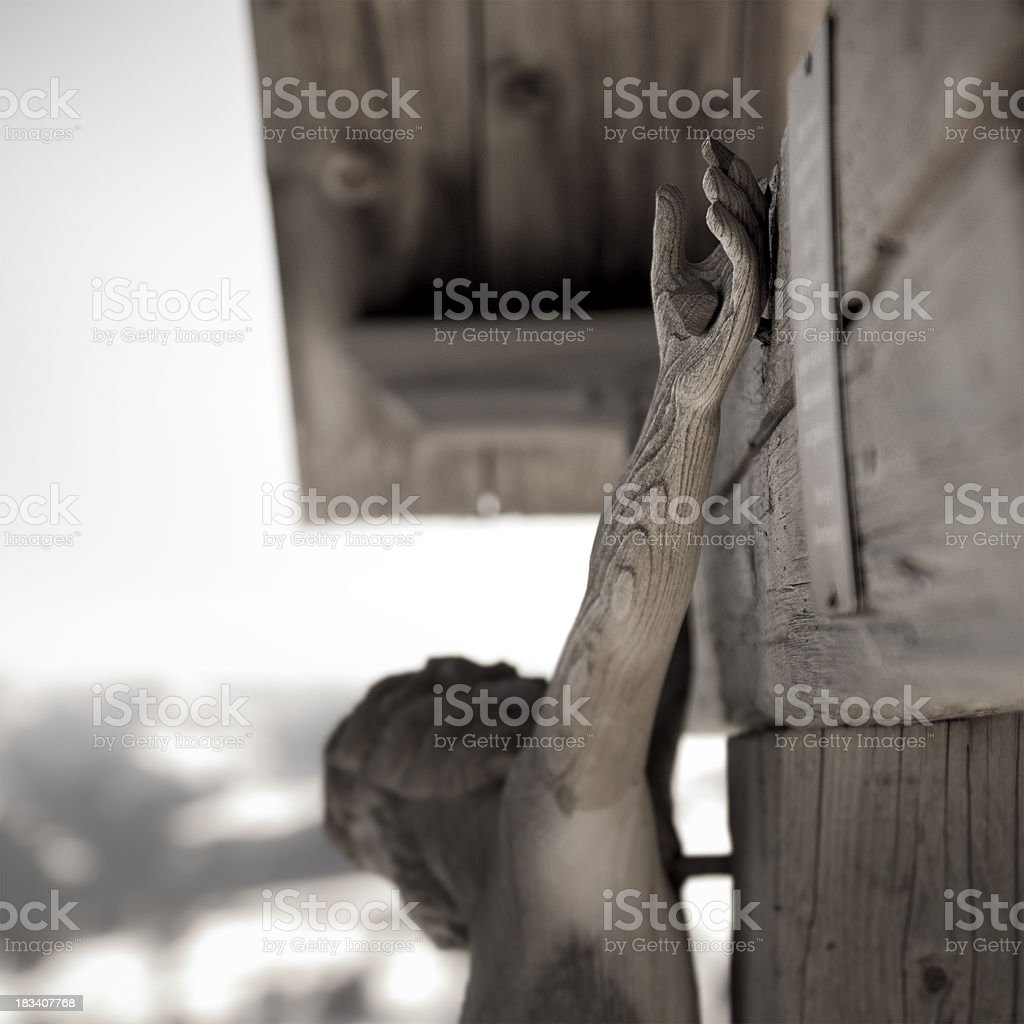 Hand of Jesus Christ, wooden crucifix stock photo
