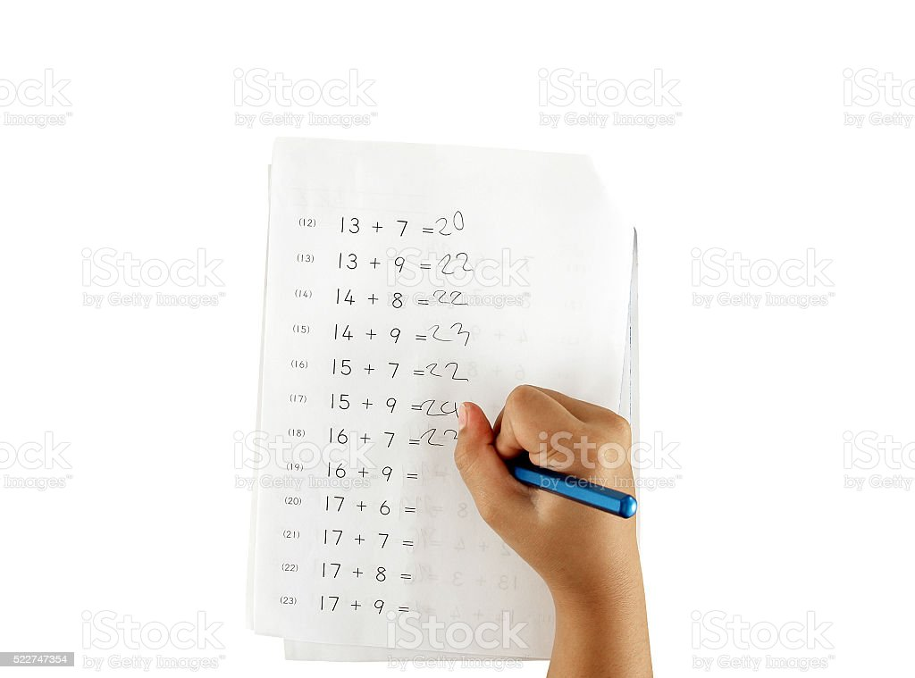 hand of little girl doing maths homework isolated on white stock photo
