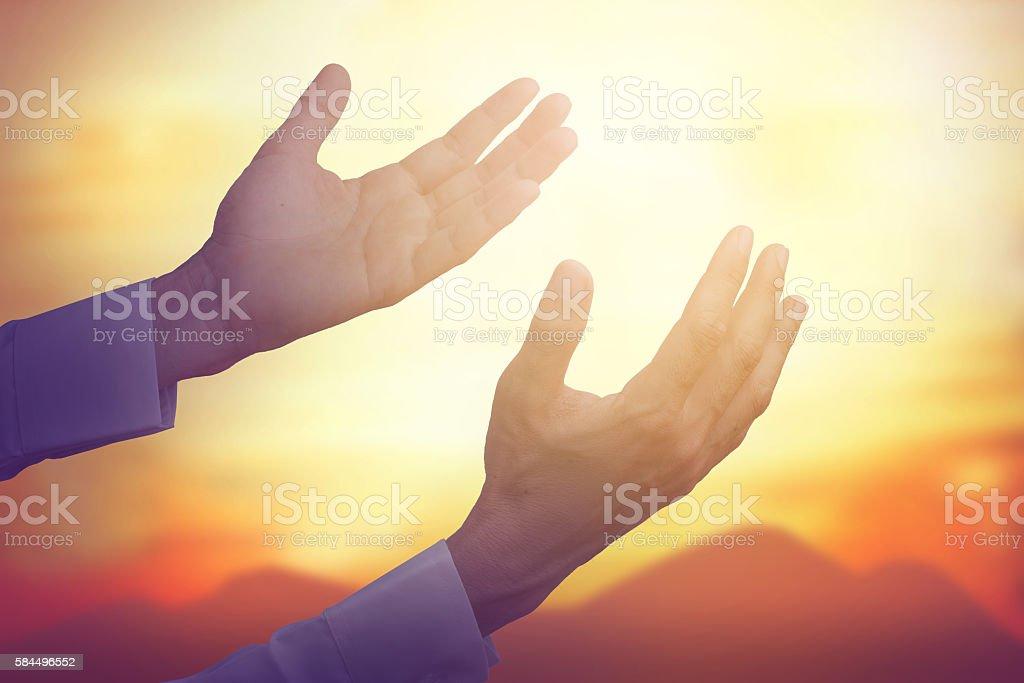 Hand of man pray for sky stock photo