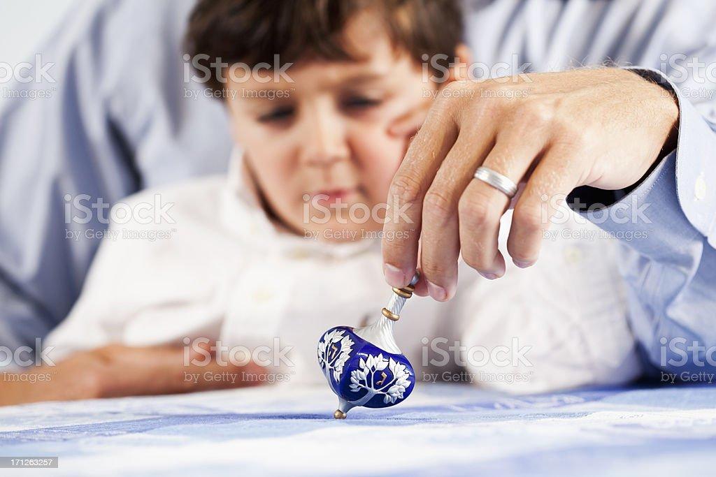 Hand of man spinning dreidl stock photo