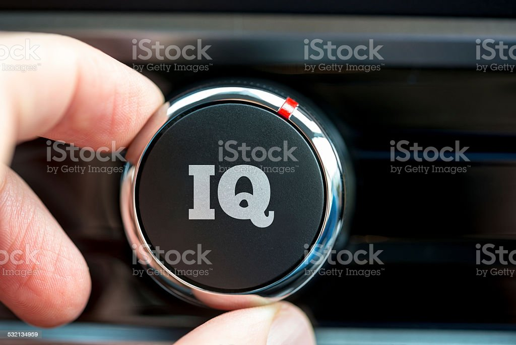 Hand of man turning up a dial with word IQ stock photo