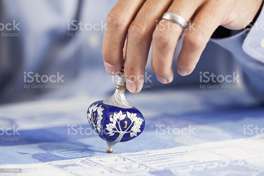 Hand of man with dreidl stock photo