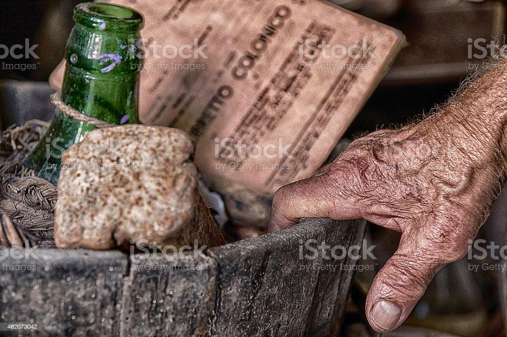 Hand of old innkeeper of Guardistallo, medieval village stock photo