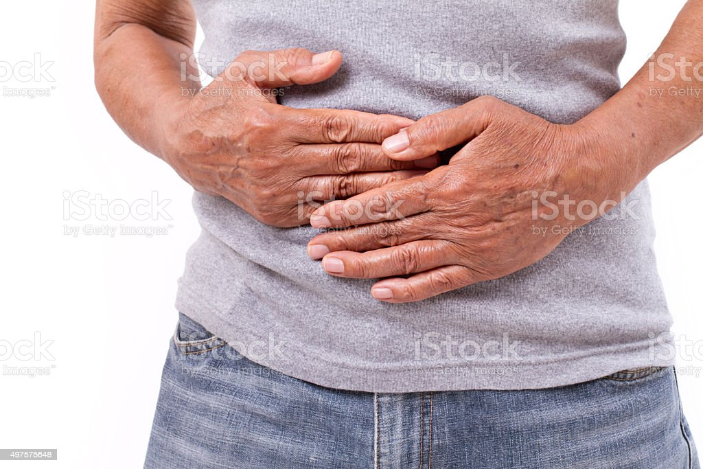 hand of old man holding stomach suffering from pain, diarrhea stock photo