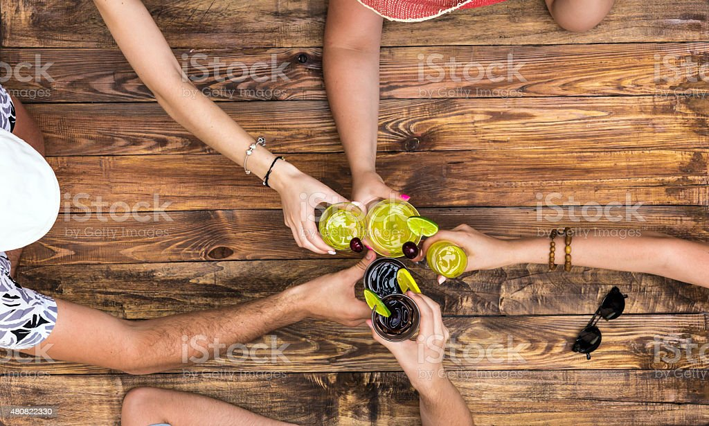 Hand of people cheers with alcohol cocktails stock photo