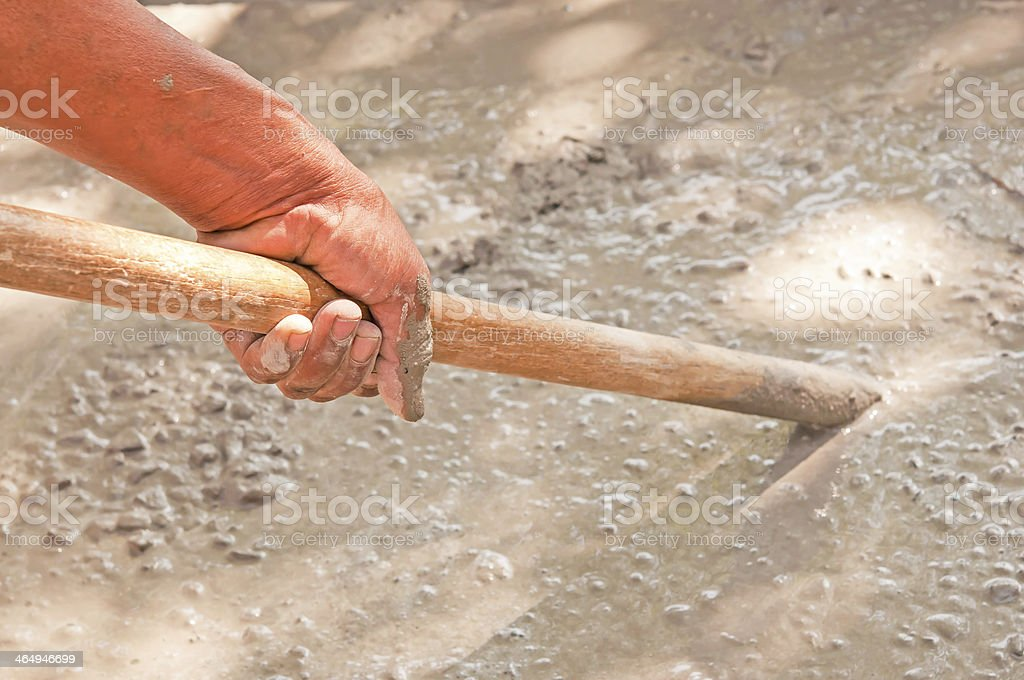 hand of plasterer mix the plaster royalty-free stock photo