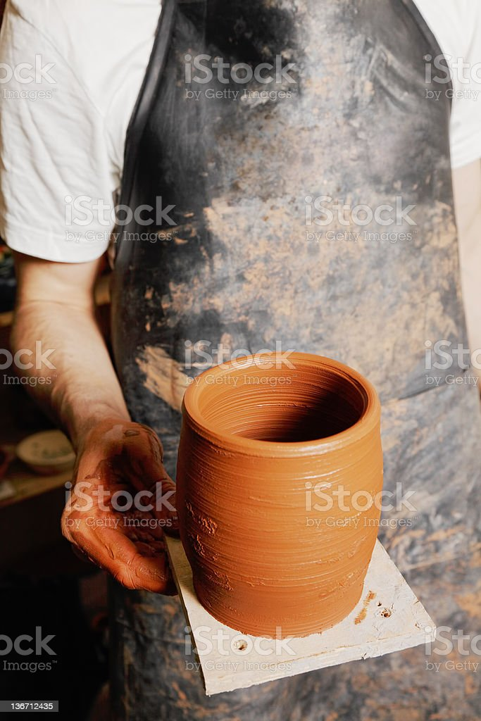 Hand of potter with jug royalty-free stock photo