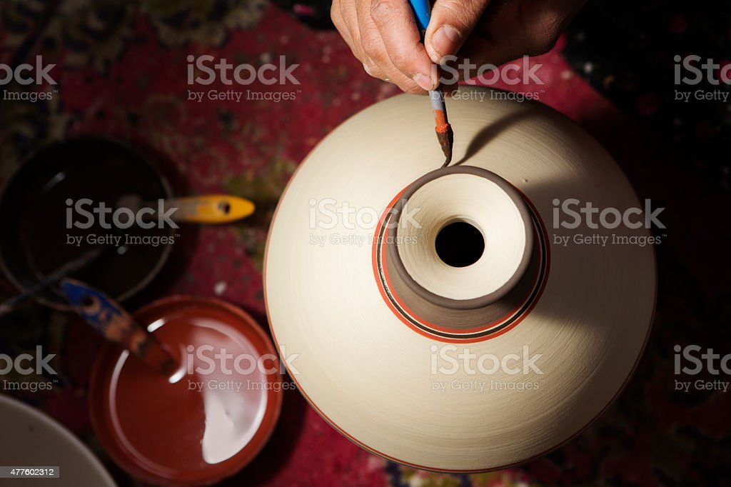 Hand of Pottery Craftsman Painting Terracotta stock photo