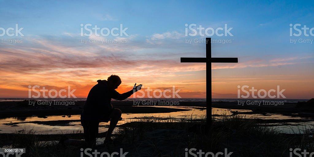 Hand of Prayer Sunset stock photo