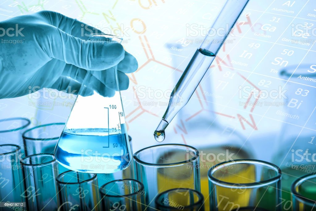 hand of scientist holding flask with test tube background stock photo