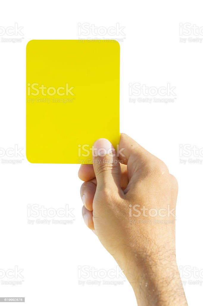 Hand of soccer referee showing yellow card stock photo