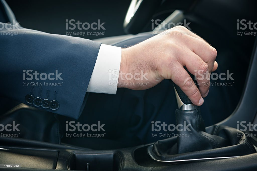 Hand of the driver of the car stock photo