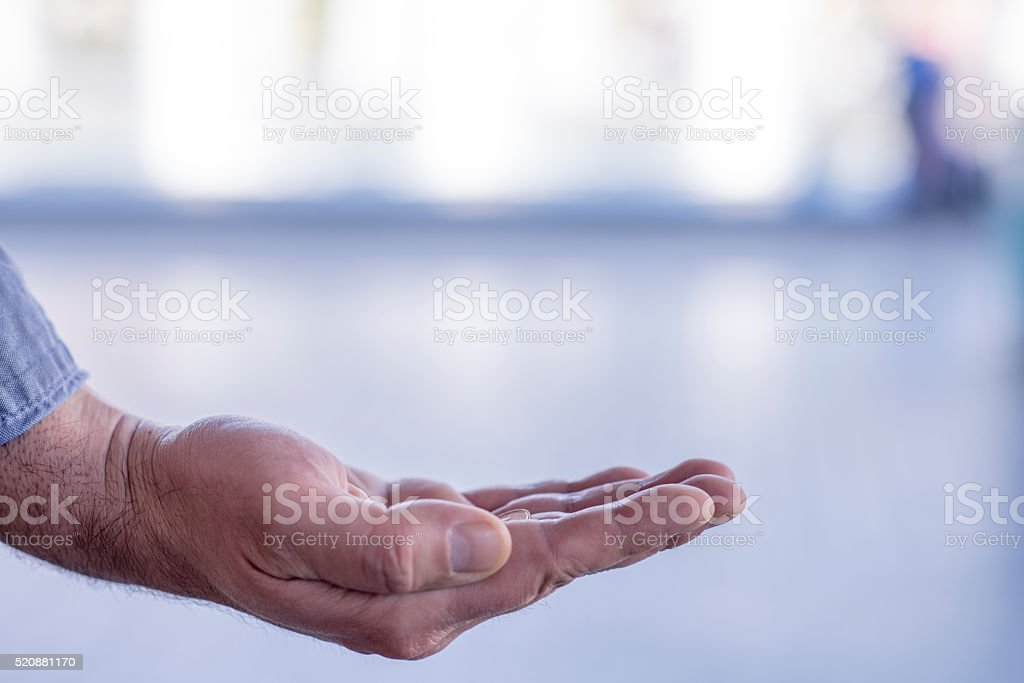 Hand of the Needy, Poor or Homeless stock photo