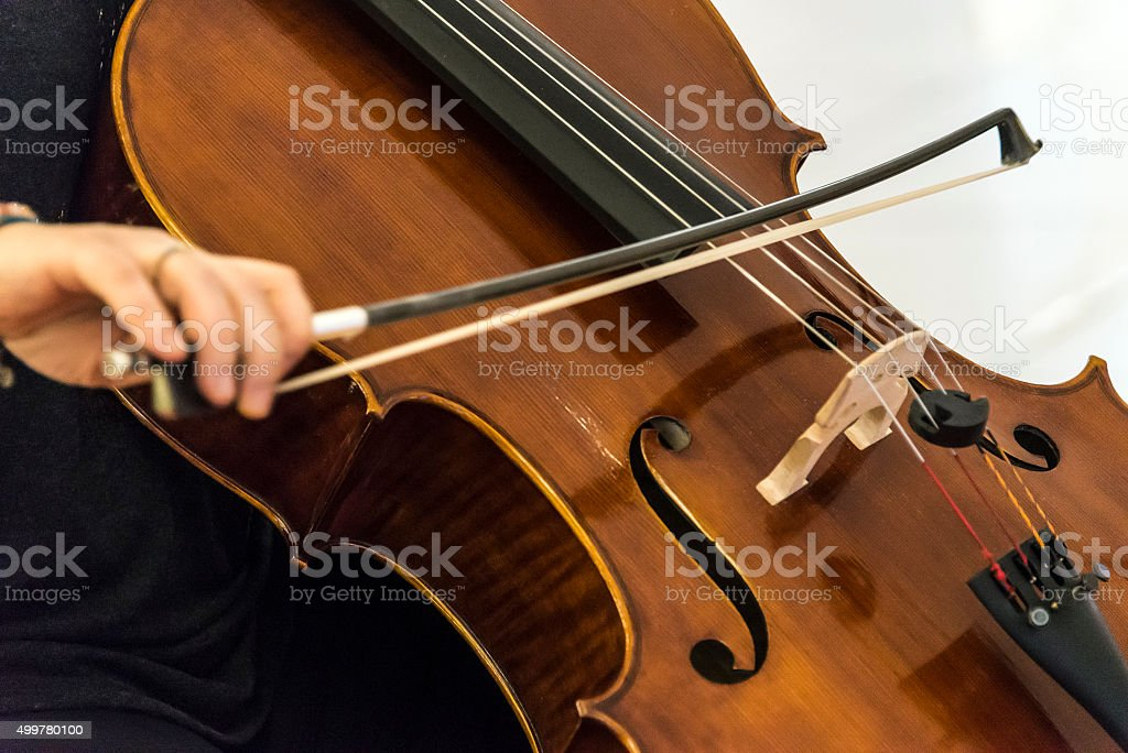 Hand of the woman playing the cello stock photo