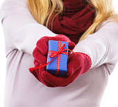 Hand of woman holding wrapped gift for Valentine