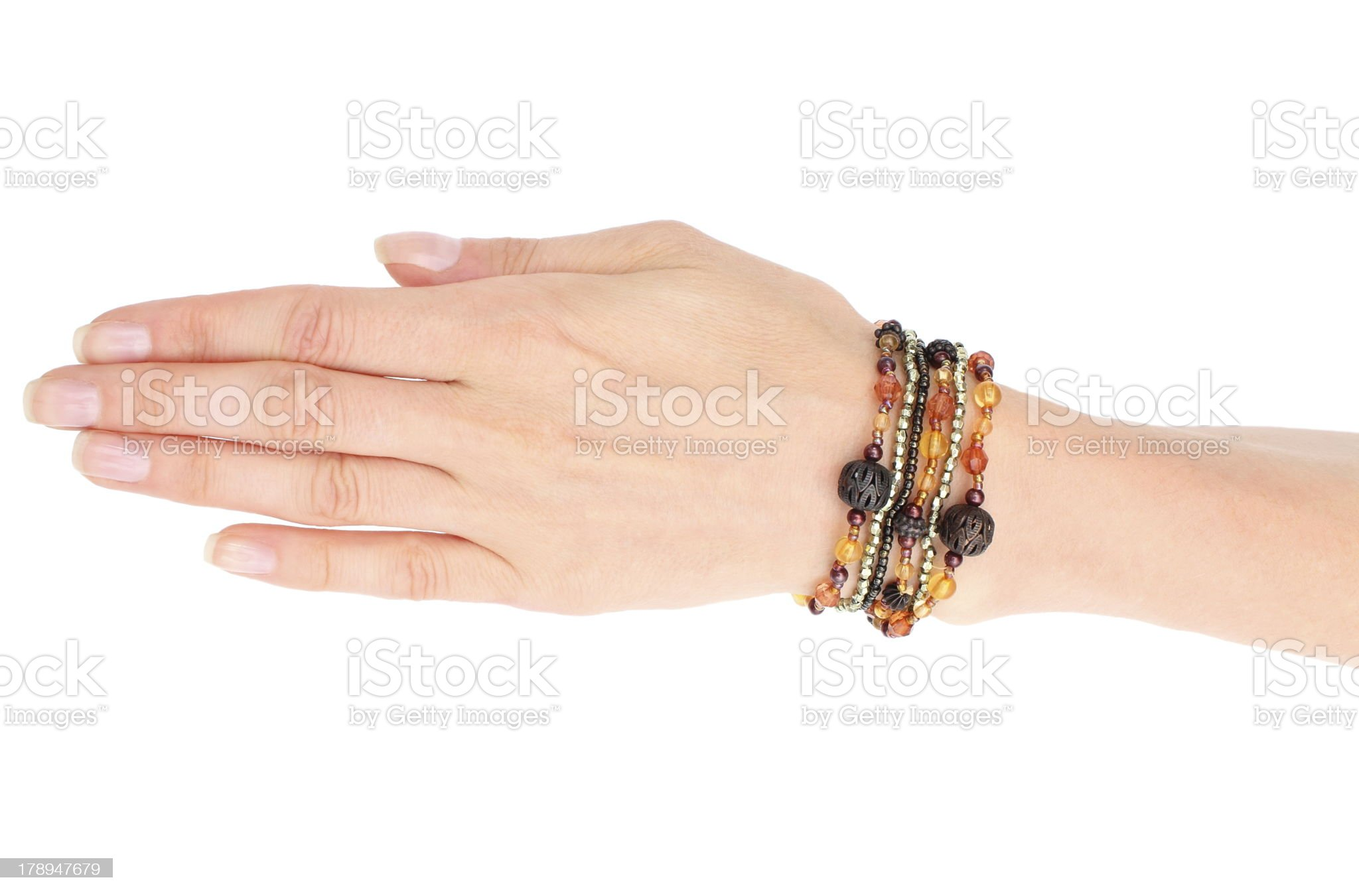 Hand of woman with bracelets on white background royalty-free stock photo